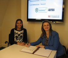 Sara Araujo and Helen Pennant exchange signed agreements