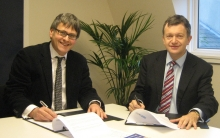 Dr Edward Kessler (Director, Woolf Institute) and Michael O'Sullivan (Trust's former Director) sign the scholarship agreement