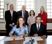 Helen Pennant and Director Ouyang sign the renewal agreement